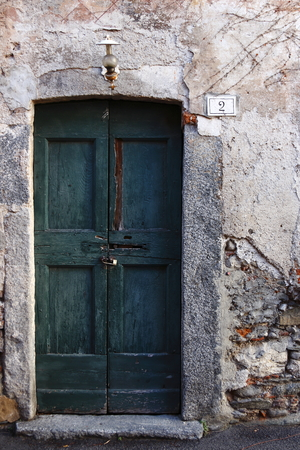 green door: old green door at number two  on a old Italian Village called Pusiano, near Como