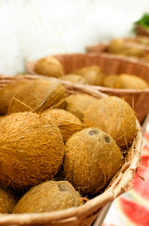 copra: many coconuts in  baskets