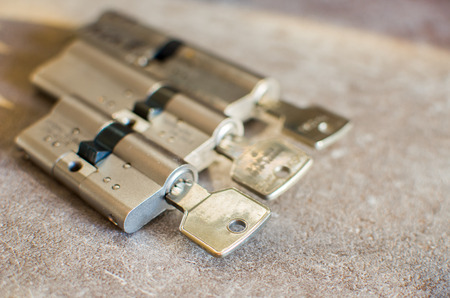 cylinder locks with their keys attached