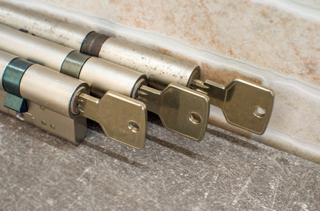 cylinder lock with their keys attached