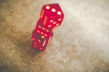 red dice: stacked red dice
