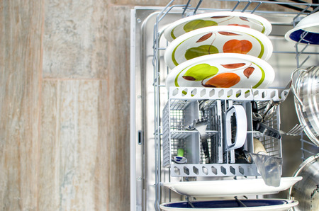 chores, clean dishes  in the dishwasher Banco de Imagens