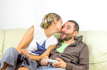 complicity: complicity couple play video games sofa
