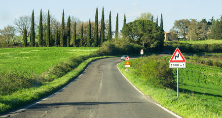 indicates: road bends road sign that indicates the curve