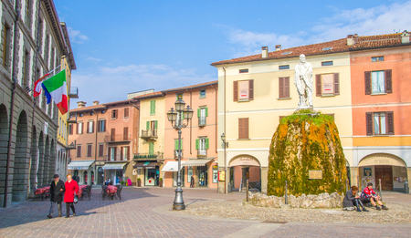 garibaldi: people walk and relax in the main square of the Iseo village named piazza Garibaldi. Editorial