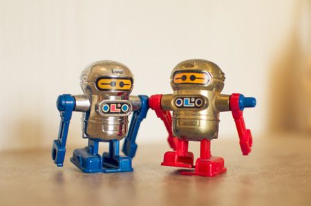 chorme: old fashioned red toy robots blu