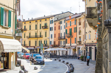 appennino: Porretta Terme, Italy - August 2, 2015 - colorful buildings, parked cars and people walking in the towns main street