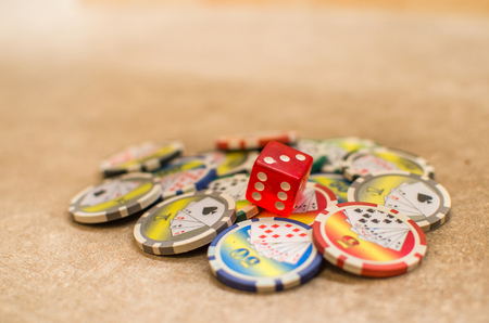 red playing dice casino tokens background