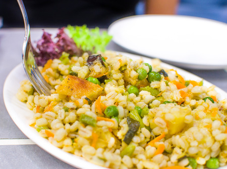 salad fork: yellow barley salad fork restaurant menu background Stock Photo