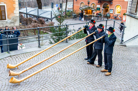 alphorn: Alphorn players perform in the historic center of Brunico Editorial