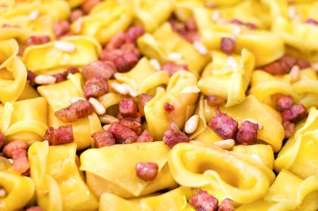 pancetta cubetti: pancetta pasta closeup cappelletti
