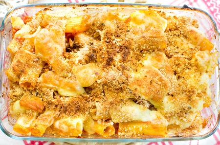 maccheroni: tortiglioni ( twisted spiral maccheroni) baked pasta mozzarella bread crumbs - pasta al forno  italian recipe Stock Photo