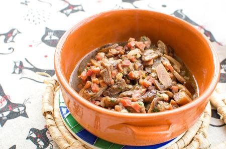 trivet: mushrooms bacon sauce orange terracotta bowl Stock Photo