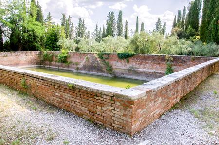 rainwater: ancient water stock rainwater collection basin inside Monte Oliveto Maggiore complex