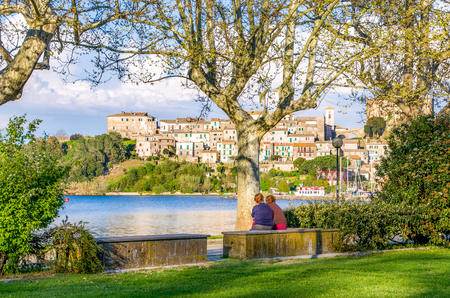 viterbo: old ladies chatting on river shore in Italy - Capodimonte - Lazio - Viterbo Stock Photo