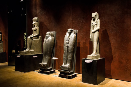 sumerian: Turin, Italy, March 8, 2013 - sumerian statues, mummies and sarcophagi inside the Turins Egyptian Museum