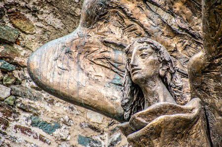 sacra: Avigliana, Italy, March 9, 2013: The statue of Saint Michael outside the walls of the Sacra of San Michele monastery Editorial