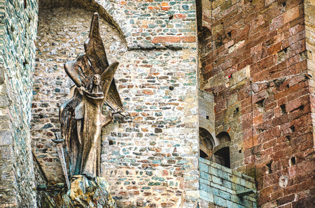 saint michael: Avigliana, Italy, March 9, 2013: The statue of Saint Michael outside the walls of the Sacra of San Michele monastery Editorial