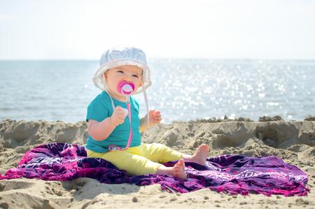 insolación: playa recién nacido