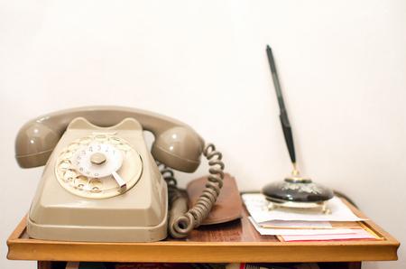old desk: vintage gray telephone handset old little desk Stock Photo