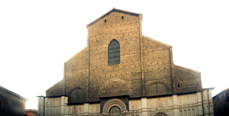 unfinished facade of San Petronio basilica in Bologna with white light backlighting