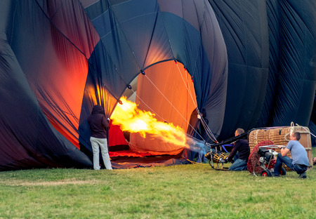 gas burner: [[[Please put it in Editorial, wrong FTP folder]]] | title: Ferrara, Italy, 09-17-2016: three hot air balloon pilots inflating hot air balloon with the burner and the fan Editorial