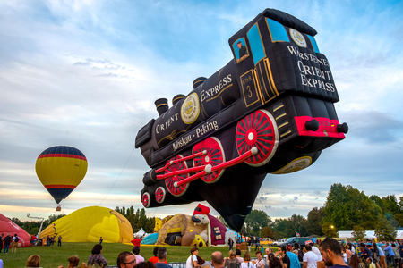 air baloon: Ferrara, Italy 16 September 2016 - A Special Shapes hot air baloon inspired by the famous Orient Express train at the Ferrara Balloons Festival Editorial