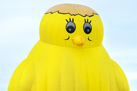 hot chick: Ferrara, Italy 16 September 2016 - giant hot air balloon in the shape of a yellow chick at the Ferrara Balloons Festival 2016