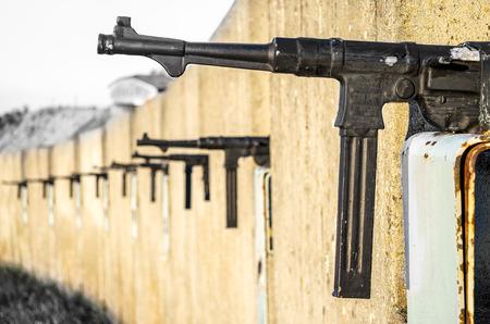 machine gun: sub machine gun trench wall Stock Photo