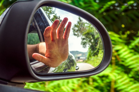 rearview mirror hand out car window
