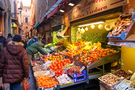 Bologna, Italy, 05 Jan 2017 - greengrocers displaying their wares in Via Pescherie Vecchie, a famous street in the historic center of Bologna