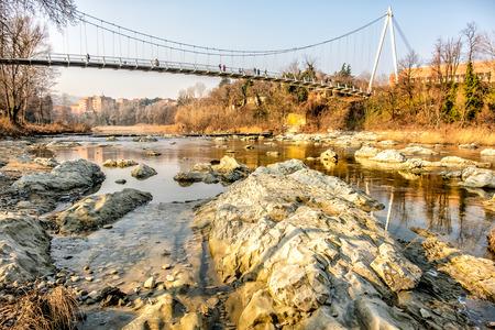 reno: footbridge river rocks from below Casalecchio di Reno Bologna Italy
