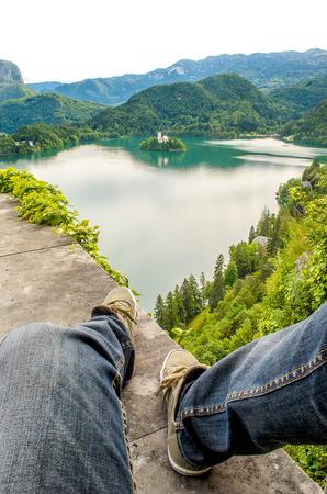 sit edge mountain lake