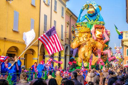 chewed: Cento, Italy, 19 feb 2017: Carnival of Cento a satirical parade float shows Donald Trump as Tarzan between monkeys Editorial