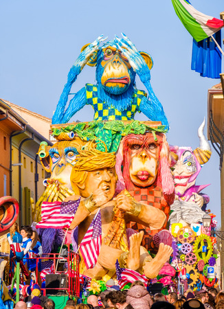 Cento, Italy, 19 feb 2017: Carnival of Cento, a satirical parade float shows Donald Trump as Tarzan between monkeys