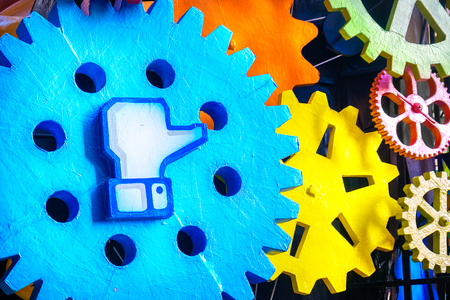 Cento, Italy, 19 feb 2017:  Facebook like symbol on a big gear. Facebook is a famous worldwide web social network