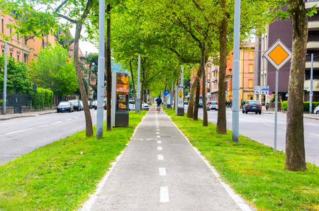 Bologna, Italy, 17 April 2016 - bicycle lane in the middle of the ring road of Bologna, best know as Viali di Bologna Editorial