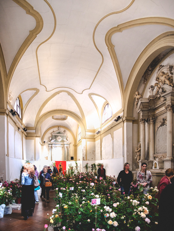 Este, Italy, 22 Apr 2017 - customers in a florist shop set up inside a deconsecrated church