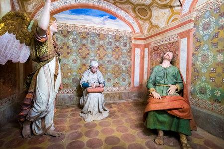 presepe: Sacro Monte di Varallo, Piedmont, Italy, May 24 2017 - biblical scene representation of Saint Joseph dreams of an angel while virgin Mary sews Editorial