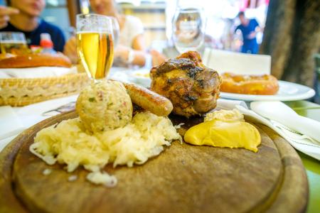 south tyrol food pork shank beer canederli kraut sausage