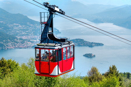 Lago Maggiore (Lake Maggiore) cableway cabin go downhill from the mount Mottarone top (Stresa, Italy, May 22 2017)