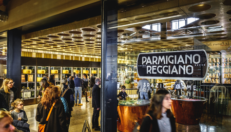 Store of Parmiggiano Reggiano cheese at Fico Eataly World full of people - Bologna, Italy, 19 Nov 2017
