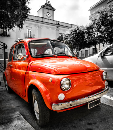 vintage red italian car old selective color black and white italy town Фото со стока