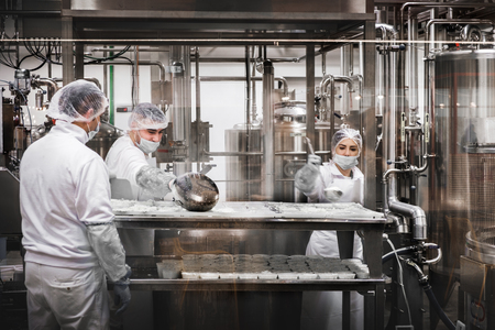workers at the cheese factory preparing Ricotta cheese at Fico Eataly World in Bologna, Italy 7 Dic 2017