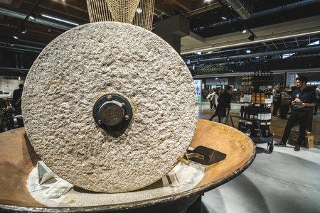 big millstones mill stone wheel inside the modern Fico Eataly World building