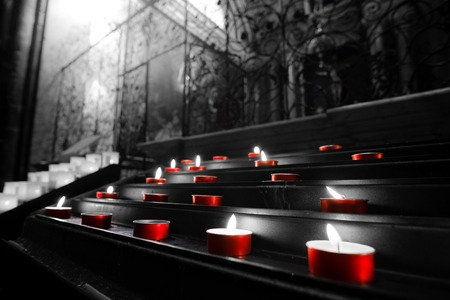 red votive candles church tealights selective color black and white