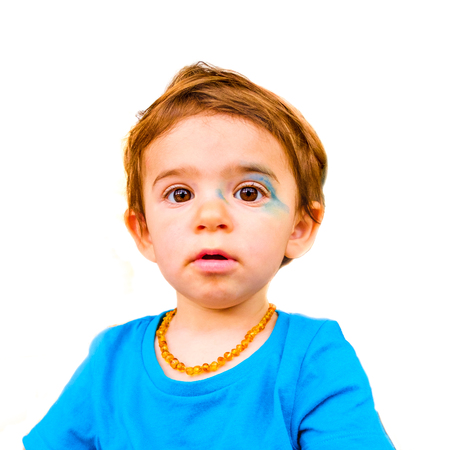 innocent baby face isolated painted blue face expression newborn 写真素材 - 94284190