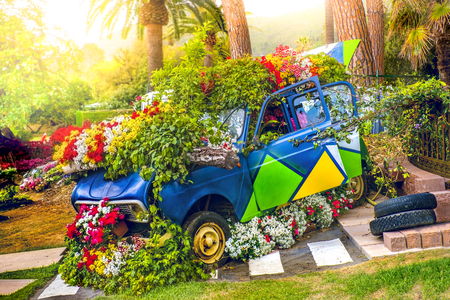 car flowers ecology concept in spring flower child green vehicle Stockfoto