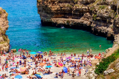 holiday makers sea lagoon small beach Polignano a Mare