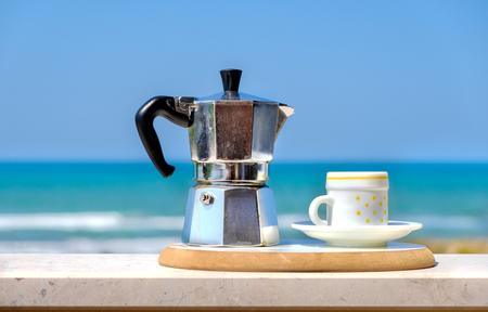 moka pot coffee maker sea background italian breakfast